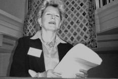 Speaker Kathleen McCreary in front of the GCR quilt