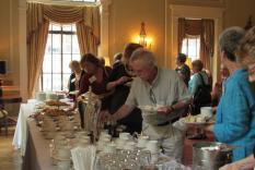 Members choosing tasty tea items (photographer Kathleen Burke)
