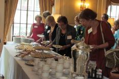 Members selecting tasty tea items (photographer Kathleen Burke)