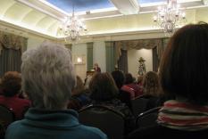 Natalie Goldman at the lecturn Dec 3 2011 (Anne Davis photographer)